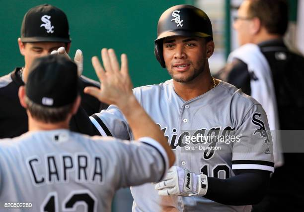 Yoan Moncada of the Chicago White Sox celebrates in the dugout after hitting a RBI triple against the Kansas City Royals during the third inning at...