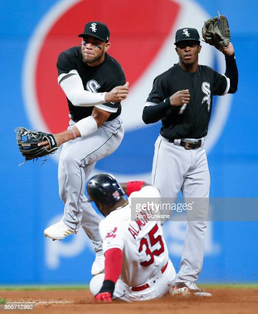 Yoan Moncada of the Chicago White Sox forces out Abraham Almonte of the Cleveland Indians at second base and throws out Giovanny Urshela at first to...