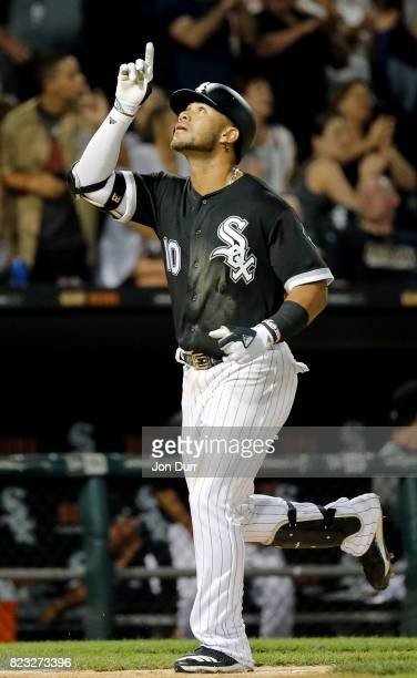 Yoan Moncada of the Chicago White Sox reacts after hitting his first career home run against the Chicago Cubs during the seventh inning at Guaranteed...