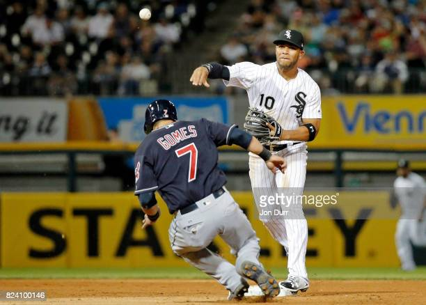 Yoan Moncada of the Chicago White Sox throws to first base after forcing out Yan Gomes of the Cleveland Indians to complete a double play to end the...