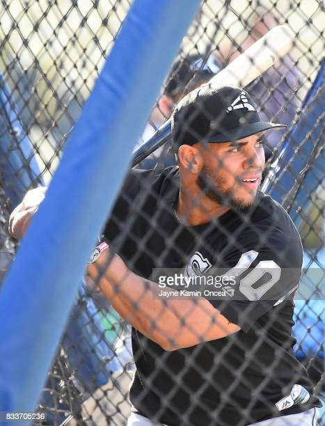 Yoan Moncada of the Chicago White Sox warms up before the game against the Los Angeles Dodgers at Dodger Stadium on August 15 2017 in Los Angeles...