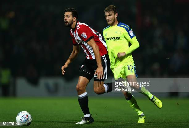 Yoann Barbet of Brentford is closed down by Sam Winnall of Derby County during the Sky Bet Championship match between Brentford and Derby County at...