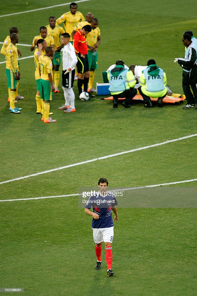 <a gi-track='captionPersonalityLinkClicked' href=/galleries/search?phrase=Yoann+Gourcuff&family=editorial&specificpeople=600434 ng-click='$event.stopPropagation()'>Yoann Gourcuff</a> of France leaves the field after being given a red card following a challenge on MacBeth Sibaya of South Africa during the 2010 FIFA World Cup South Africa Group A match between France and South Africa at the Free State Stadium on June 22, 2010 in Mangaung/Bloemfontein, South Africa.
