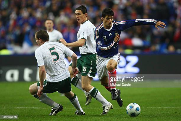 Yoann Gourcuff of France skips past Richard Dunne and Keith Andrews of Ireland during the France v Republic of Ireland FIFA 2010 World Cup Qualifying...