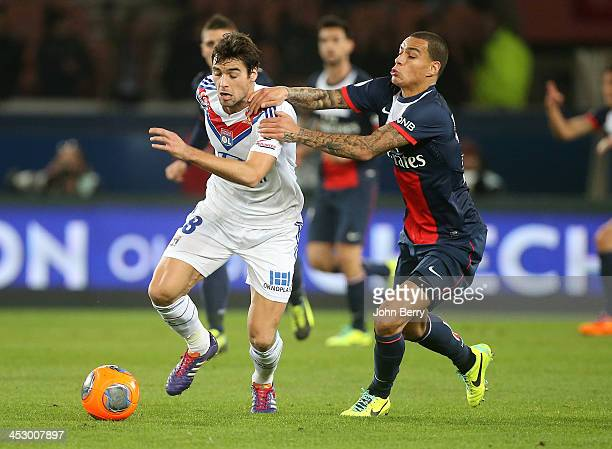 Yoann Gourcuff of Lyon and Gregory Van Der Wiel of PSG in action during the French Ligue 1 match between Paris SaintGermain FC and Olympique Lyonnais...