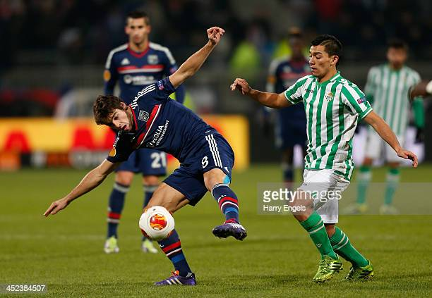 Yoann Gourcuff of Lyon is challenged by Juanfran of Real Betis during the UEFA Europa League Group I match between Olympique Lyonnais and Real Betis...