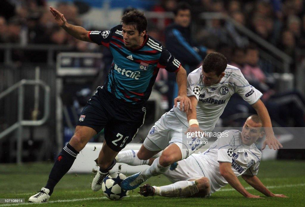 <a gi-track='captionPersonalityLinkClicked' href=/galleries/search?phrase=Yoann+Gourcuff&family=editorial&specificpeople=600434 ng-click='$event.stopPropagation()'>Yoann Gourcuff</a> of Lyonnais is challenged by <a gi-track='captionPersonalityLinkClicked' href=/galleries/search?phrase=Lukas+Schmitz&family=editorial&specificpeople=6269299 ng-click='$event.stopPropagation()'>Lukas Schmitz</a> and <a gi-track='captionPersonalityLinkClicked' href=/galleries/search?phrase=Peer+Kluge&family=editorial&specificpeople=635201 ng-click='$event.stopPropagation()'>Peer Kluge</a> of Schalke during the UEFA Champions League group B match between FC Schalke 04 and Olympique Lyonnais at Veltins Arena on November 24, 2010 in Gelsenkirchen, Germany.