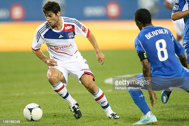 Yoann Gourcuff of Olympique Lyonnais stops the ball and turns in front of Patrice Bernier of the Montreal Impact during the MLS match at the Saputo...