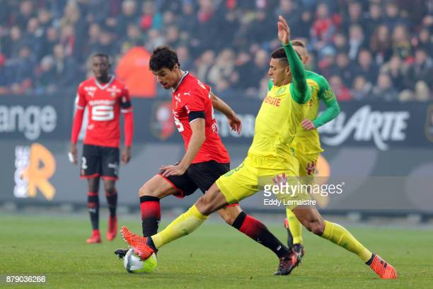 Yoann Gourcuff of Rennes and Diego Carlos of Nantes during the Ligue 1 match between Stade Rennais and Nantes at Roazhon Park on November 25 2017 in...