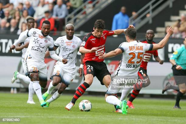 Yoann Gourcuff of Rennes and Mathieu Deplagne of Montpellier during the Ligue 1 match between Stade Rennais and Montpellier Herault at Roazhon Park...