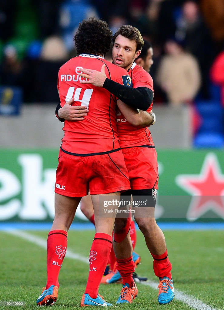 Yoann Huget and Vincent Clerc of Toulouse celebrates their teams win over Glasgow Warriors during the European Rugby Champions Cup Pool 4 match...