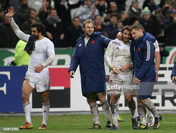 Yoann Huget Antonie Claassen Maxime Medard and Benjamin Kayser of France celebrate the victory at the end of the RBS Six Nations match between France...