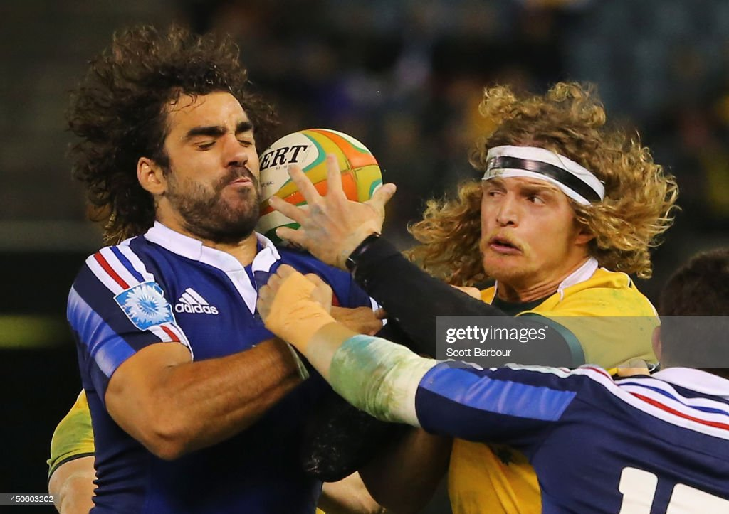 Yoann Huget of France and Nick Cummins of the Wallabies compete for the ball during the second International Test Match between the Australian Wallabies and France at Etihad Stadium on June 14, 2014 in Melbourne, Australia.