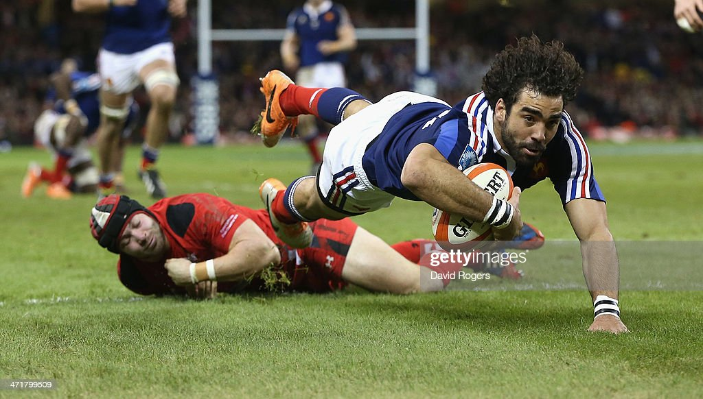 Yoann Huget of France avoids the challenge from Leigh Halfpenny as he dives over the try line but his effort was dissalowed by referee Alain Rolland during the RBS Six Nations match between Wales and France at the Millennium Stadium on February 21, 2014 in Cardiff, Wales.