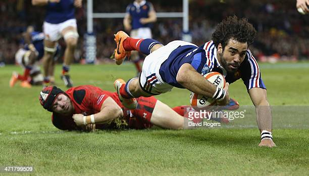 Yoann Huget of France avoids the challenge from Leigh Halfpenny as he dives over the try line but his effort was dissalowed by referee Alain Rolland...
