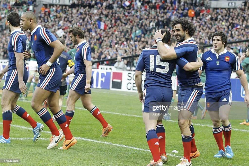 Yoann Huget (R) of France celebrate his try with team-matte during the RBS 6 Nations match between France and Ireland at Stade de France on march 15, 2014 in Paris, France.