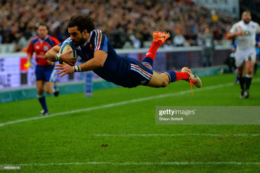 <a gi-track='captionPersonalityLinkClicked' href=/galleries/search?phrase=Yoann+Huget&family=editorial&specificpeople=683912 ng-click='$event.stopPropagation()'>Yoann Huget</a> of France goes over to score their second try during the RBS Six Nations match between France and England at Stade de France on February 1, 2014 in Paris, France.