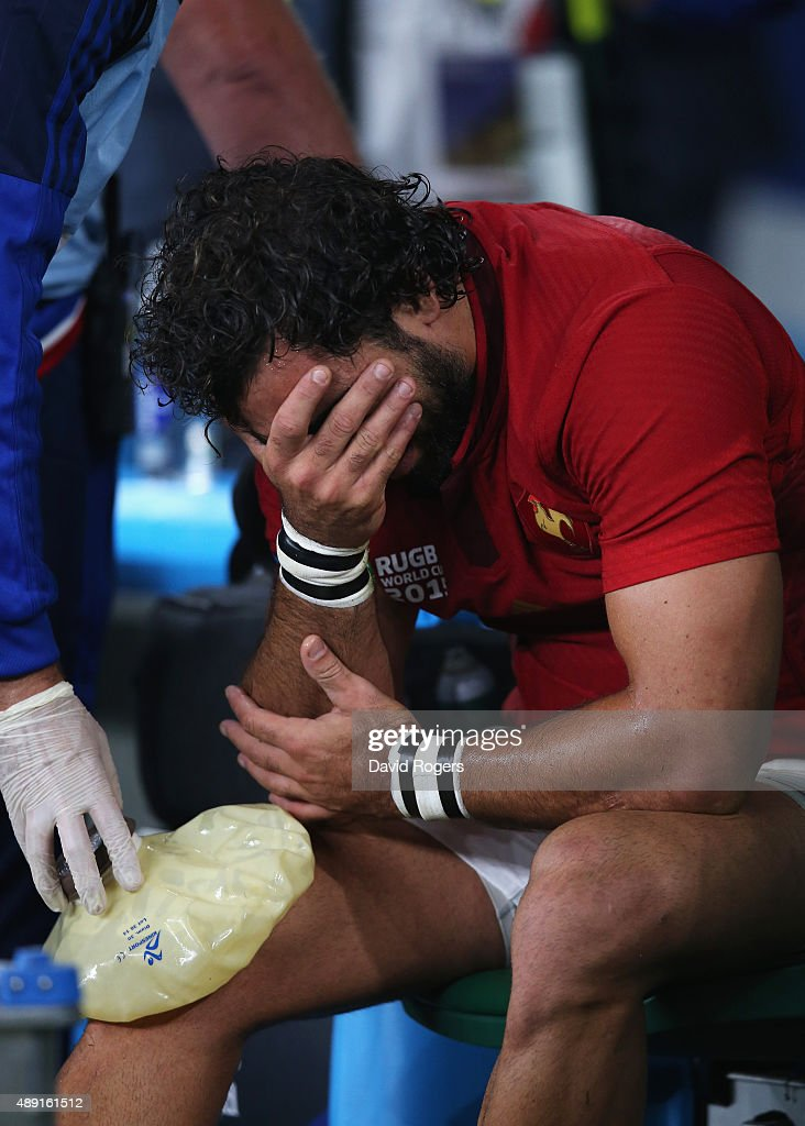 Yoann Huget of France is distraught following his injury during the 2015 Rugby World Cup Pool D match between France and Italy at Twickenham Stadium on September 19, 2015 in London, United Kingdom.