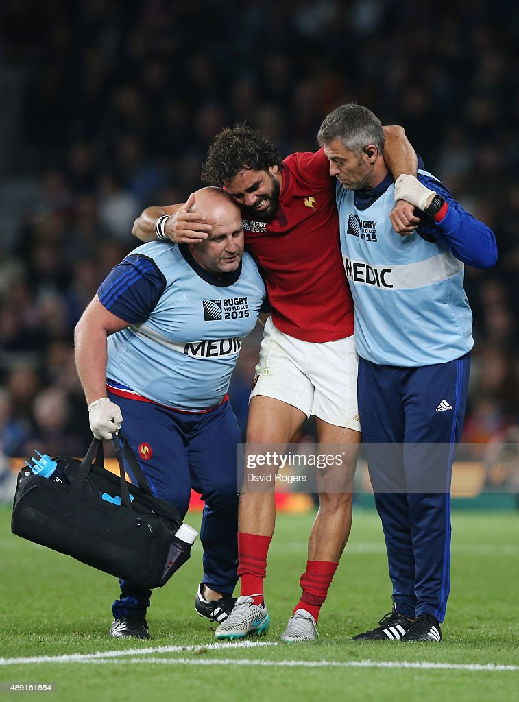 Yoann Huget of France is helped from the field following his injury during the 2015 Rugby World Cup Pool D match between France and Italy at Twickenham Stadium on September 19, 2015 in London, United Kingdom.