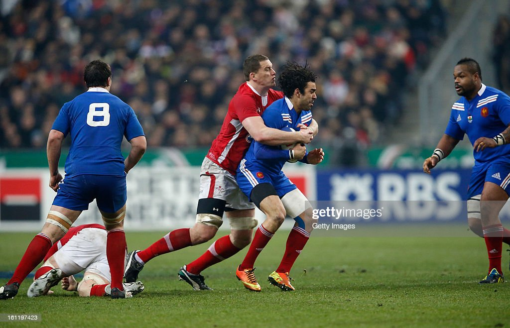 Yoann Huget of France is tackled by Ian Evans of Wales during the RBS Six Nations match between France and Wales at Stade de France on February 9, 2013 in Paris, France.