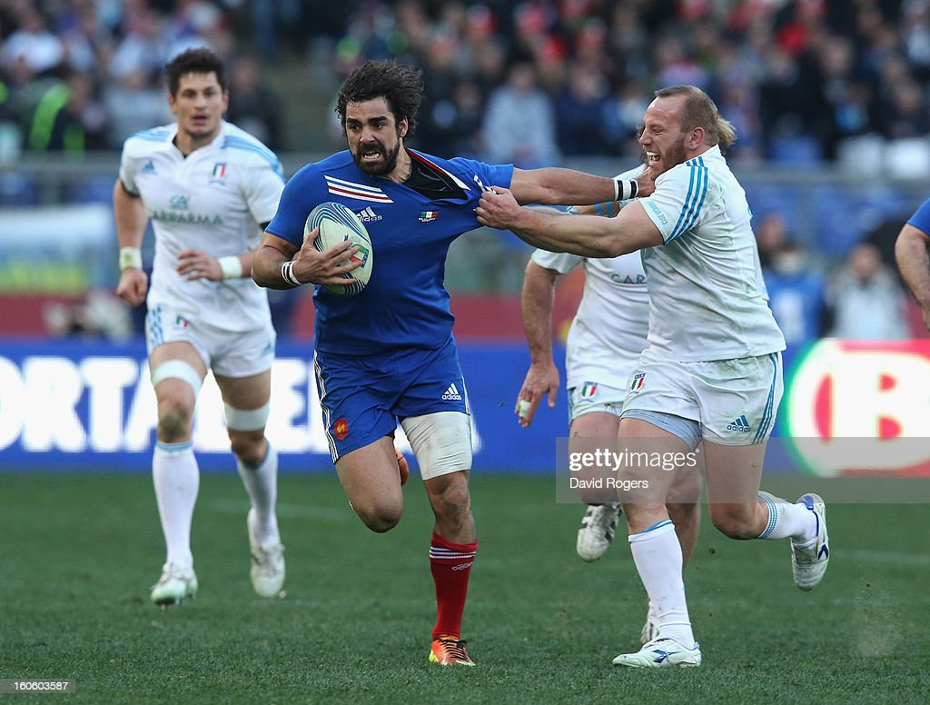 <a gi-track='captionPersonalityLinkClicked' href=/galleries/search?phrase=Yoann+Huget&family=editorial&specificpeople=683912 ng-click='$event.stopPropagation()'>Yoann Huget</a> of France is tackled by <a gi-track='captionPersonalityLinkClicked' href=/galleries/search?phrase=Leonardo+Ghiraldini&family=editorial&specificpeople=4505425 ng-click='$event.stopPropagation()'>Leonardo Ghiraldini</a> during the RBS Six Nations match between Italy and France at Stadio Olimpico on February 3, 2013 in Rome, Italy.