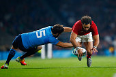 Yoann Huget of France is tackled by Luke McLean of Italy during the 2015 Rugby World Cup Pool D match between France and Italy at Twickenham Stadium...