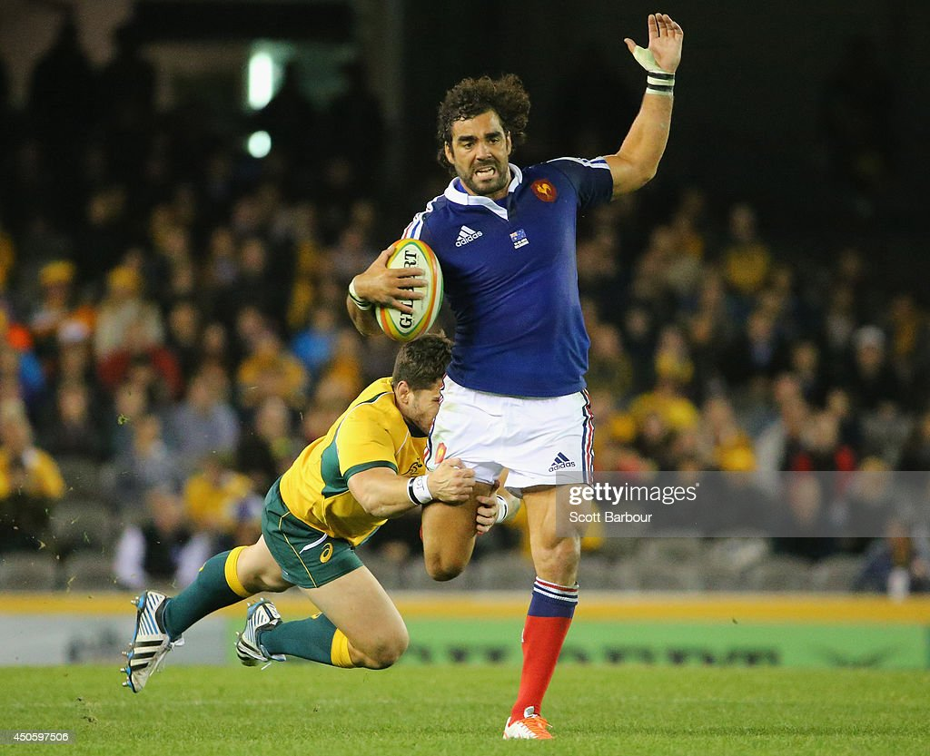<a gi-track='captionPersonalityLinkClicked' href=/galleries/search?phrase=Yoann+Huget&family=editorial&specificpeople=683912 ng-click='$event.stopPropagation()'>Yoann Huget</a> of France is tackled during the second International Test Match between the Australian Wallabies and France at Etihad Stadium on June 14, 2014 in Melbourne, Australia.