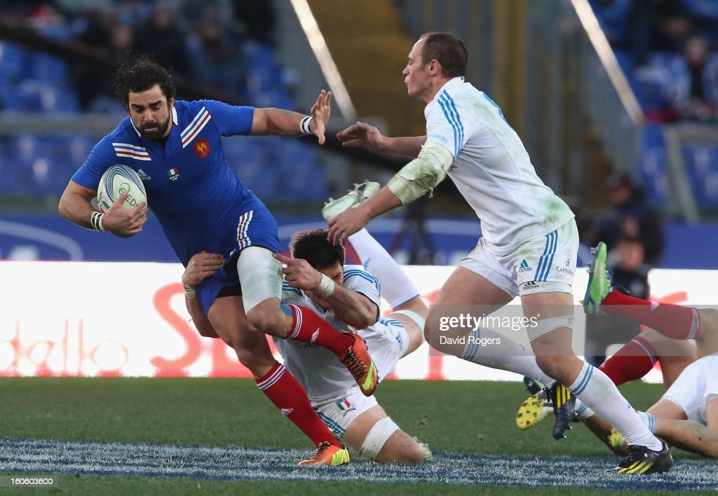 <a gi-track='captionPersonalityLinkClicked' href=/galleries/search?phrase=Yoann+Huget&family=editorial&specificpeople=683912 ng-click='$event.stopPropagation()'>Yoann Huget</a> of France is tackledi during the RBS Six Nations match between Italy and France at Stadio Olimpico on February 3, 2013 in Rome, Italy.