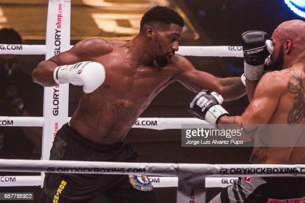 Yoann Kongolo of Switzerland fifth against Cedric Doumced of France during a Welterweight Glory kickboxing title fight at Forest National Arena on...