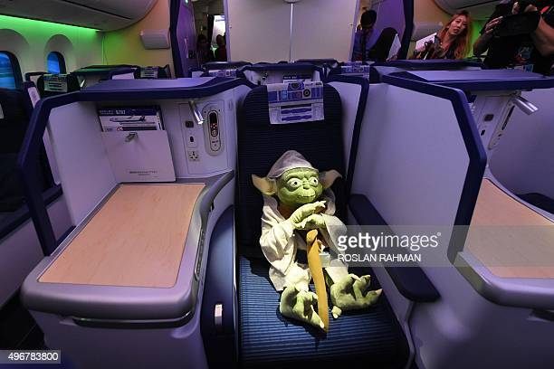 Yoda the popular Jedi Master from the Star Wars film universe is seen on board an All Nippon Airways Boeing 787 aircraft painted in special livery of...