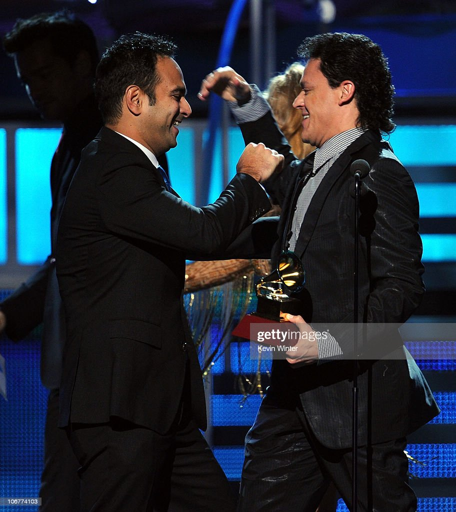 Yoel Henriquez (L) and Pedro Fernandez accept the Best Regional Mexican Song award onstage during the 11th annual Latin GRAMMY Awards at the Mandalay Bay Events Center on November 11, 2010 in Las Vegas, Nevada.