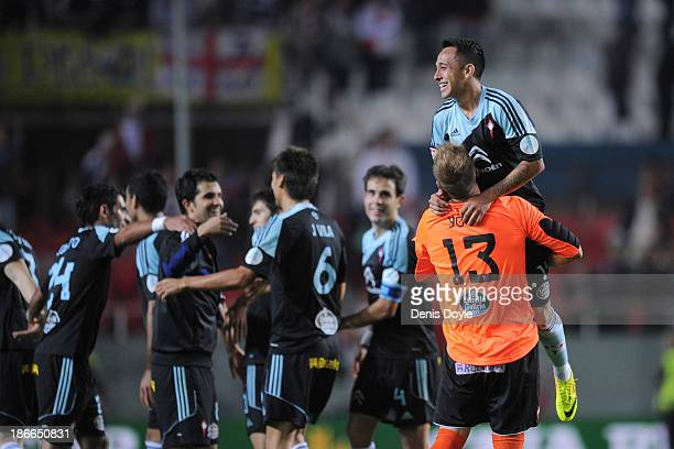 Yoel Rodriguez of Celta de Vigo celebrates with Fabian Orellana after their team beat Sevilla FC 10 in the La Liga match between Sevilla FC and Celta...