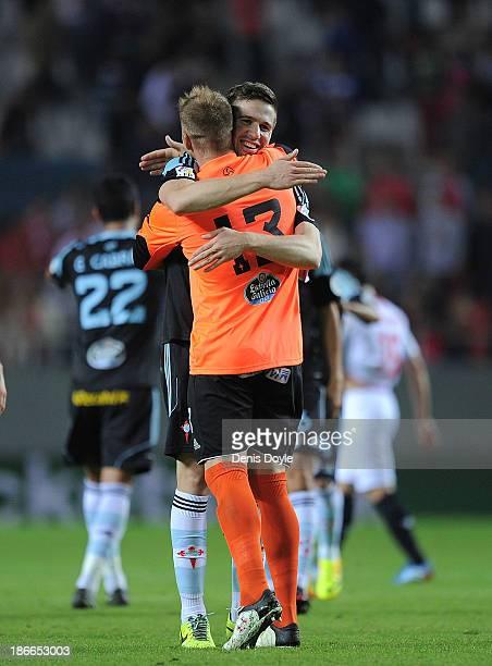 Yoel Rodriguez of Celta de Vigo celebrates with teammate Andreu Fontas after Celta beat Sevilla FC 10 in the La Liga match between Sevilla FC and...
