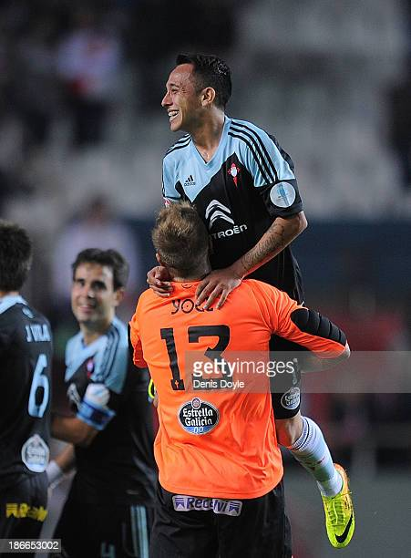 Yoel Rodriguez of Celta de Vigo celebrates with teammate Fabian Orellana after their team beat Sevilla FC 10 in the La Liga match between Sevilla FC...