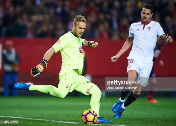 Yoel Rodriguez of SD Eibar being followed by Victor Machin Perez 'Vitolo' of Sevilla FC during the La Liga match between Sevilla FC and SD Eibar at...