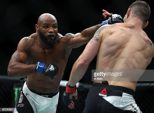 Yoel Romero of Cuba fights against Chris Weidman of the United States in their middleweight bout during the UFC 205 event at Madison Square Garden on...