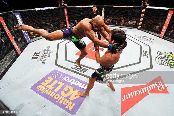 Yoel Romero of Cuba lunges at Lyoto Machida of Brazil in their middleweight during the UFC Fight Night event at the Hard Rock Live on June 27 2015 in...
