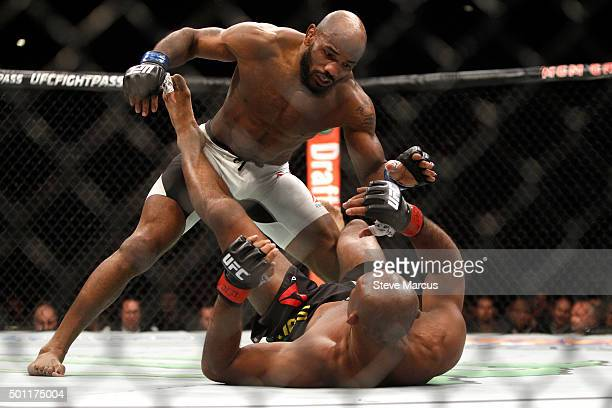 Yoel Romero stands over Ronaldo Souza in a middleweight fight during UFC 194 at MGM Grand Garden Arena on December 12 2015 in Las Vegas Nevada