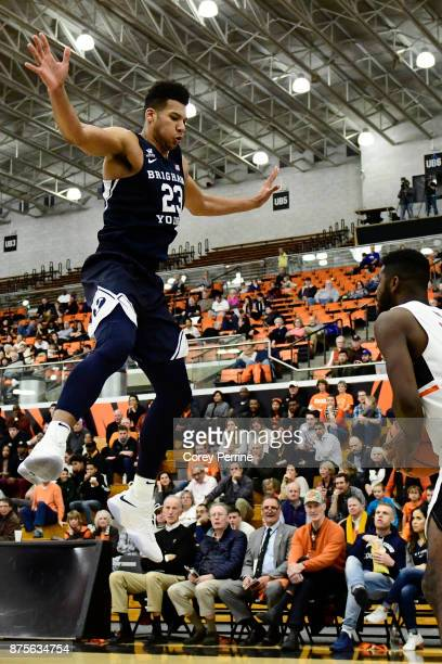 Yoeli Childs of the Brigham Young Cougars defends against Amir Bell of the Princeton Tigers during the second half at L Stockwell Jadwin Gymnasium on...
