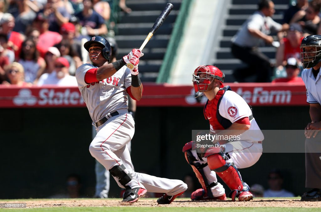 Yoenis Cedspedes #52 of the Boston Red Sox hits a three run home run to break a scoreless tie in the eighth inning against the Los Angeles Angels of Anaheim at Angel Stadium of Anaheim on August 10, 2014 in Anaheim, California.