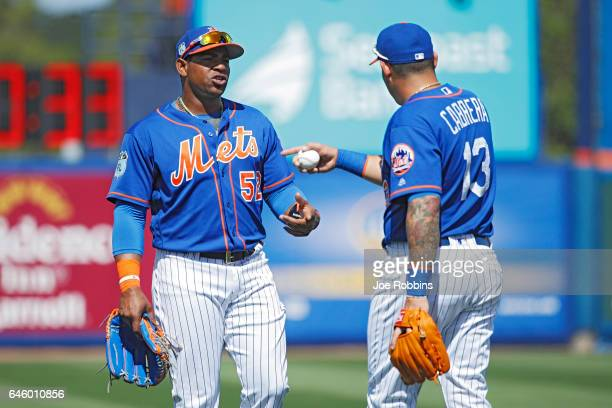 Yoenis Cespedes and Asdrubal Cabrera of the New York Mets talk in between innings of a spring training game against the Houston Astros at Tradition...