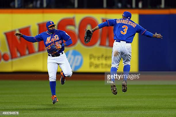 Yoenis Cespedes and Curtis Granderson of the New York Mets celebrate after defeating the Chicago Cubs in game two of the 2015 MLB National League...