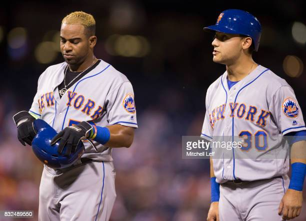 Yoenis Cespedes and Michael Conforto of the New York Mets look on against the Philadelphia Phillies at Citizens Bank Park on August 11 2017 in...