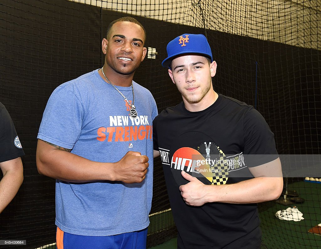 Yoenis Cespedes and Nick Jonas pose in the batting cages before a New York Mets game at Citi Field on July 7 2016 in New York City
