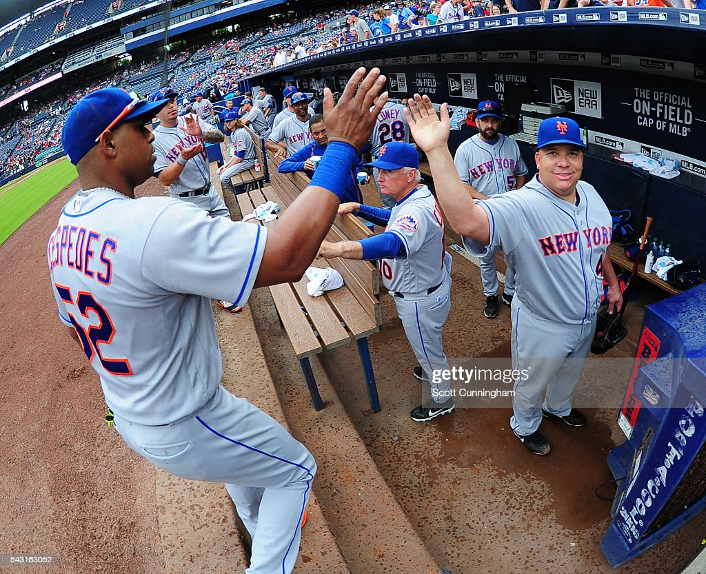 <a gi-track='captionPersonalityLinkClicked' href=/galleries/search?phrase=Yoenis+Cespedes&family=editorial&specificpeople=8892047 ng-click='$event.stopPropagation()'>Yoenis Cespedes</a> #52 is congratulated by <a gi-track='captionPersonalityLinkClicked' href=/galleries/search?phrase=Bartolo+Colon&family=editorial&specificpeople=175812 ng-click='$event.stopPropagation()'>Bartolo Colon</a> #40 of the New York Mets after making a catch to end the fifth inning against the Atlanta Braves at Turner Field on June 26, 2016 in Atlanta, Georgia.