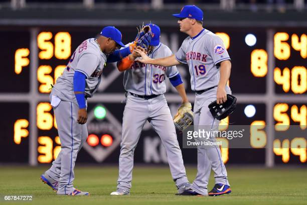 Yoenis Cespedes Michael Conforto and Jay Bruce of the New York Mets celebrate after defeating the Philadelphia Phillies 54 at Citizens Bank Park on...