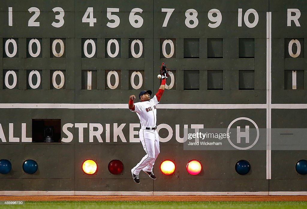 Yoenis Cespedes #52 of the Boston Red Sox fails to make a catch in left field allowing two runs to score in the 8th inning against the Tampa Bay Rays during the game at Fenway Park on September 23, 2014 in Boston, Massachusetts.