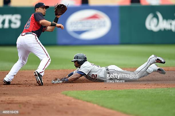 Yoenis Cespedes of the Detroit Tigers slides into second base ahead of a tag by Daniel Castro of the Atlanta Braves during the first inning of a...
