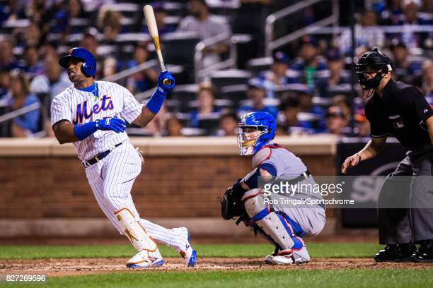 Yoenis Cespedes of the New York Mets bats during the game against the Los Angeles Dodgers at Citi Field on August 4 2017 in the Queens borough of New...