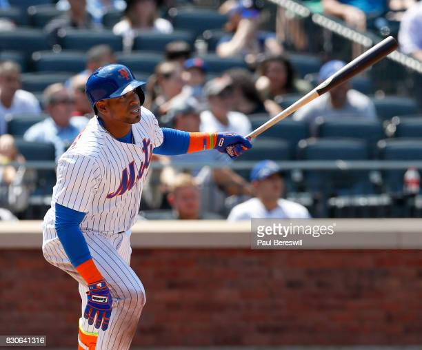 Yoenis Cespedes of the New York Mets bats in an interleague MLB baseball game against the Texas Rangers on August 9 2017 at CitiField in the Queens...